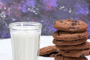 glass of milk and round  cookies