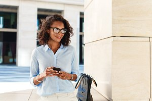 Smiling woman with smartphone