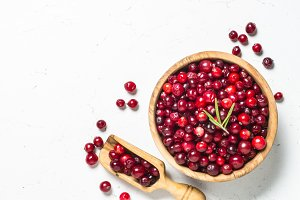 Cranberry in wooden bowl on white