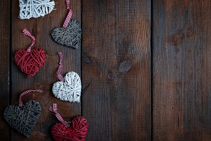 wicker hearts on a brown board