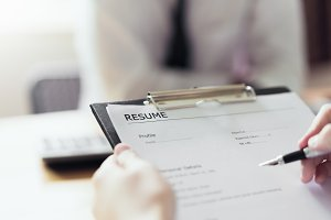 Young woman submit resume employer t