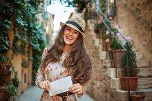 happy stylish tourist woman with map