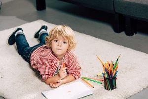 selective focus of little boy painti