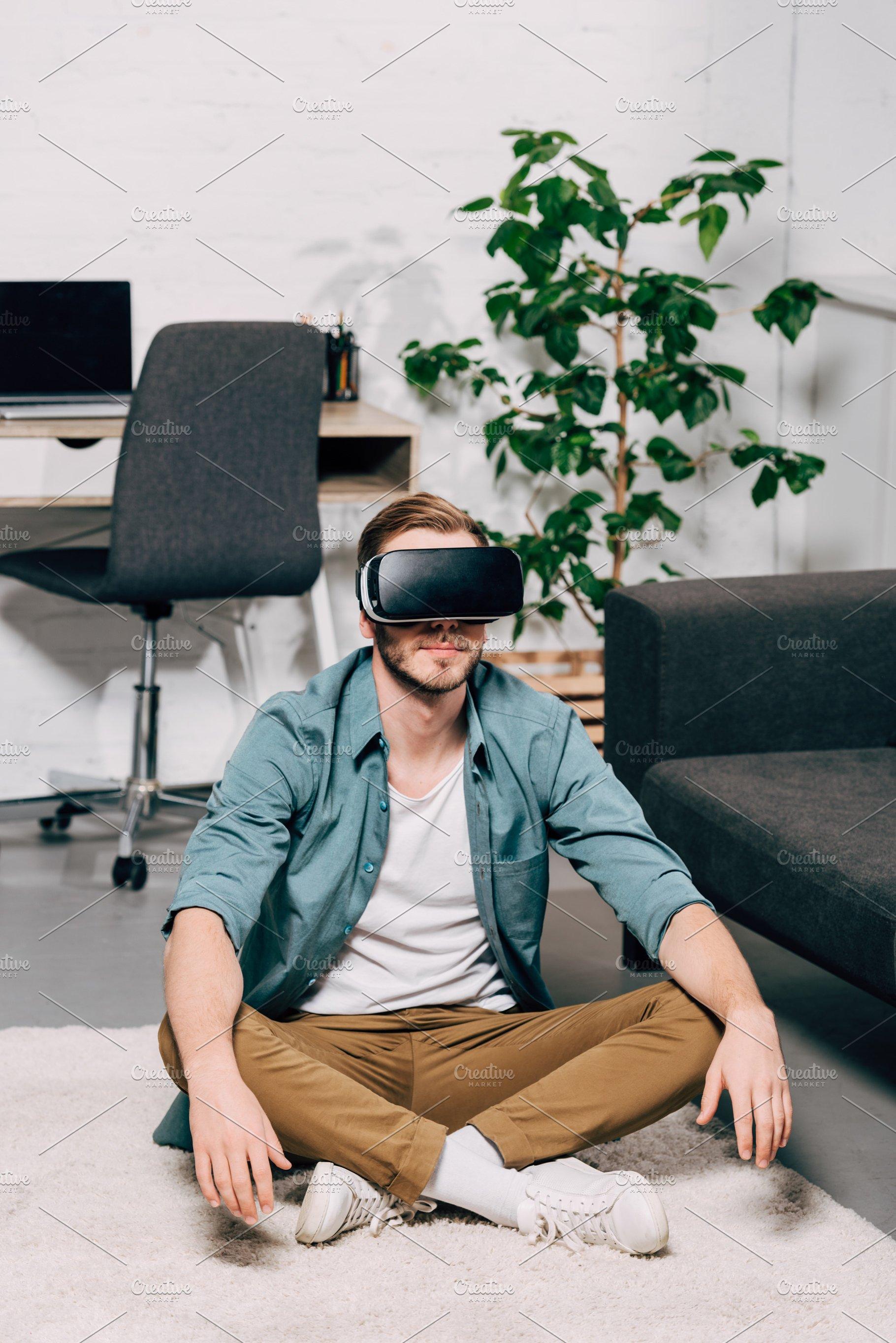 af71b6cc423e young man using virtual reality head ~ People Photos ~ Creative Market