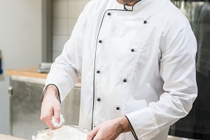 Male baker in chefs uniform