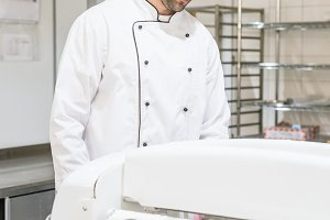 Baker in white chef uniform