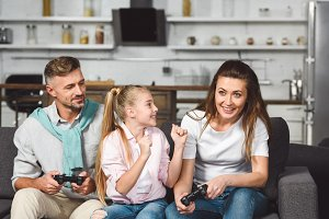 happy family playing video game toge