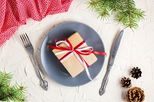 Christmas table setting with gift on