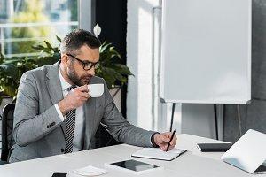 focused businessman in eyeglasses dr
