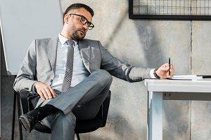 bored businessman sitting at workpla
