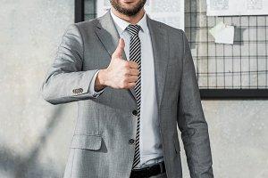 handsome businessman showing thumb u
