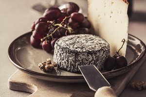 Red wine and cheese plate with fruit