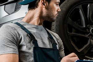 Young repairman during work
