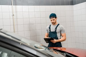 portrait of auto mechanic with notep