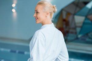 Beautiful woman standing in bathrobe