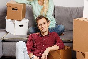 Image of couple sitting among