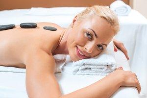Beautiful woman lying on massage tab