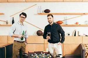 portrait of young men with beer stan