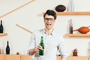 portrait of happy man in eyeglasses