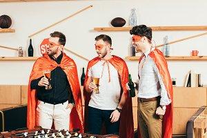 portrait of young men in superhero c
