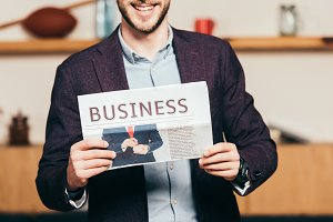 partial view of cheerful businessman