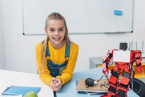 adorable schoolgirl smiling, looking