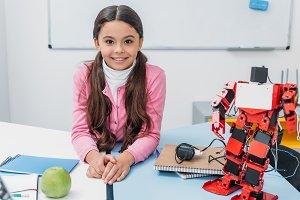 adorable smiling schoolgirl sitting