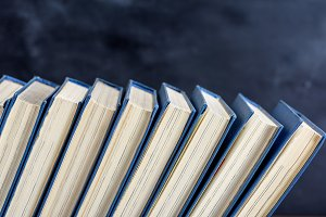 books with blue cover, black backgro