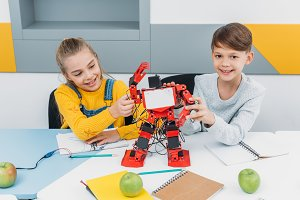 happy classmates presenting robot du