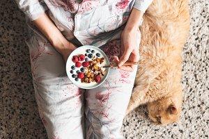 Girl eating healthy breakfast bowl