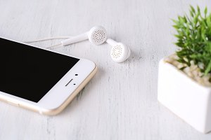 Close-up of earphone on modern phone