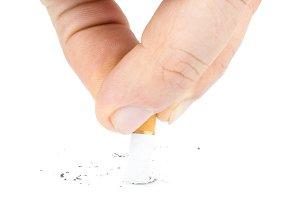 man puts out a cigarette