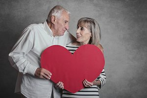 senior couple with a red heart