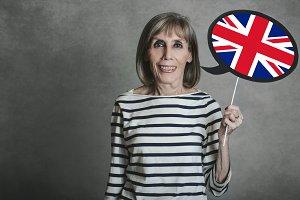 senior woman with the English flag