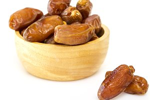 Bowl of dried dates on white