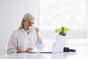 Woman working at home on a laptop
