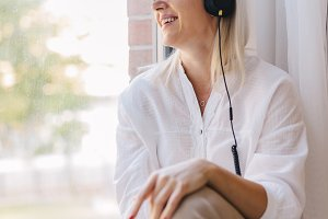 Woman listening to music, looking th