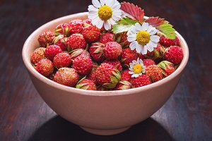 strawberries in a bowl and chamomile