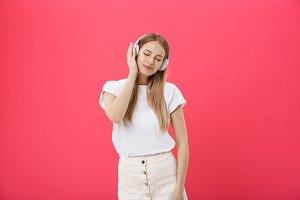Funny woman with headphones dancing