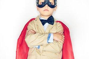 Brave little boy wearing a superhero
