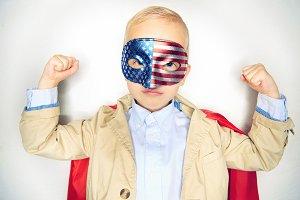 Cute little boy wearing a superhero