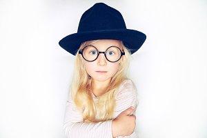Cute little blonde girl wearing a st