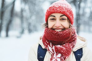 Happy cheerful smiling woman in warm