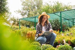 Woman gardener working near flowers