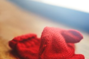 red knitted mittens on the table