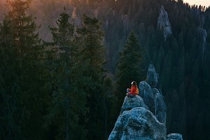 woman standing on edge of cliff