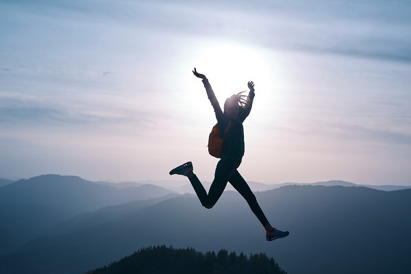People Stock Photos: vitaliymateha photography - woman jumping on mountain on sunset