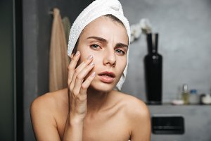 Photo of displeased woman with towel