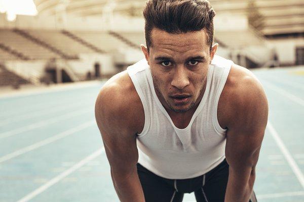 Sports Stock Photos: Jacob Lund - Sprinter standing on running track