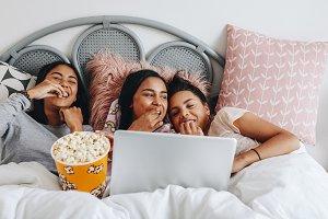 Girls enjoying a movie on laptop